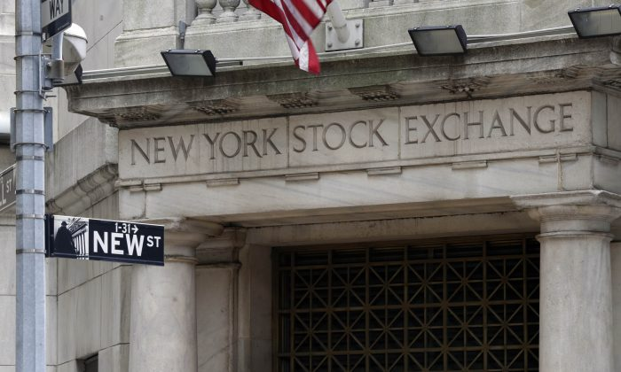 The Wall Street entrance of the New York Stock Exchange, Thursday, Oct. 2, 2014. Global stock markets drifted higher Wednesday Dec. 2, 2014, after Chinese business surveys offered some optimism about the world's No. 2 economy. (AP Photo/Richard Drew)