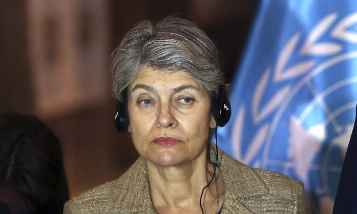 Irina Bokova, the Director-General of the United Nations Educational, Scientific and Cultural Organization (UNESCO) listens to a question during a press conference at the Iraqi National Museum in Baghdad, Iraq, on Nov. 2, 2014. She's already the first female and Eastern European to head UNESCO, and could be the first female and Eastern European United Nations secretary-general, too - if her government gets its way and she wins support from the five U.N. Security Council members. (AP Photo/Khalid Mohammed)