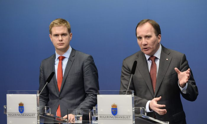 Sweden's Prime Minister Stefan Lofven (R), of the Social Democrats, and Minister of Education Gustav Fridolin (L), of the Green Party, give a press conference at the government chancellery in Stockholm, Sweden, on Wednesday, Dec. 3, 2014, where Lofven announced fresh elections after his coalition government failed to get its budget through parliament. (AP Photo/TT News Agency/Pontus Lundahl)