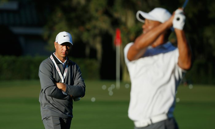 Swing instructor Chris Como (L) has his work cut out for him in trying to get Tiger Woods back on top of the golf world. (Scott Halleran/Getty Images)