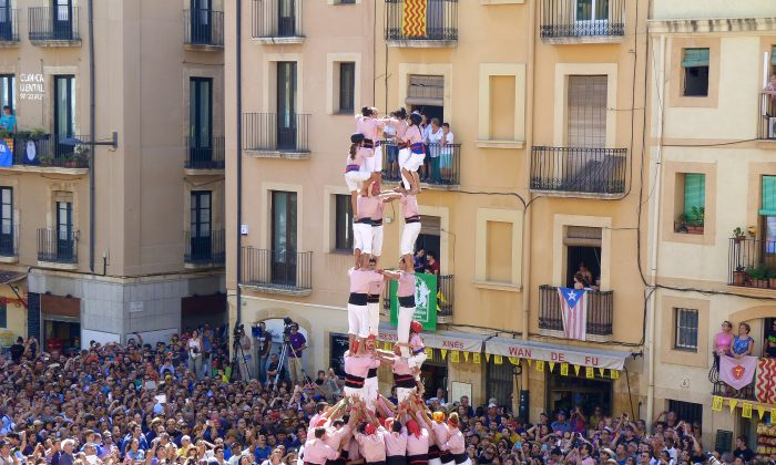 The crowd gathers to watch a human tower form at at the 10-day Santa Tecla Festival in Tarragona, Spain. The towers can reach hundreds of feet high and involve several hundred individuals. (Manos Angelakis)