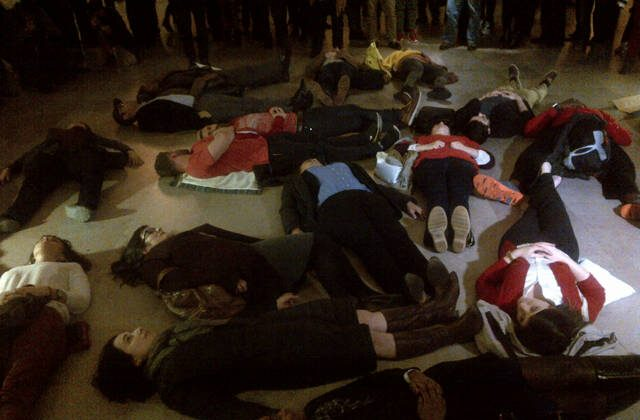 "Protesters stage a ""die in"" at Grand Central Station. (Petr Svab/Epoch Times)"