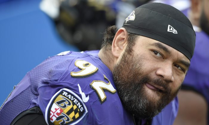 FILE - In this Nov. 9, 2014, file photo, Baltimore Ravens defensive end Haloti Ngata watches the action from the sidelines during the second half of an NFL football game against the Tennessee Titans in Baltimore. Ngata has been suspended without pay for four games for violating the NFL's policy on performance enhancing substances, the league announced Thursday, Dec. 4, 2014.  (AP Photo/Nick Wass, File)