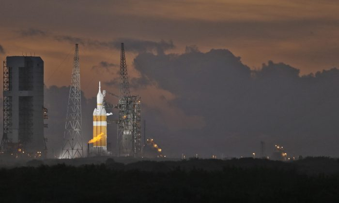 NASA's Orion spacecraft, atop a  United Launch Alliance Delta 4-Heavy rocket, sits on the launch pad before its first scheduled unmanned orbital test flight from the Cape Canaveral Air Force Station, Thursday, Dec. 4, 2014, in Cape Canaveral, Fla. (AP Photo/Chris O'Meara)