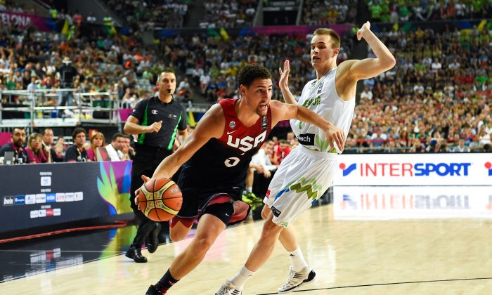 Klay Thompson #5 of the USA Basketball Men's National Team runs with the ball against Klemen Prepelic #7 of the Slovenia Basketball Men's National Team during 2014 FIBA Basketball World Cup quarter-final match between Slovenia and USA at Palau Sant Jordi on September 9, 2014 in Barcelona, Spain. (Photo by David Ramos/Getty Images)