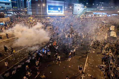 Demonstrators disperse as tear gas is fired by police during a protest on Sept. 28, 2014, in Hong Kong. (Anthony Kwan/Getty Images)