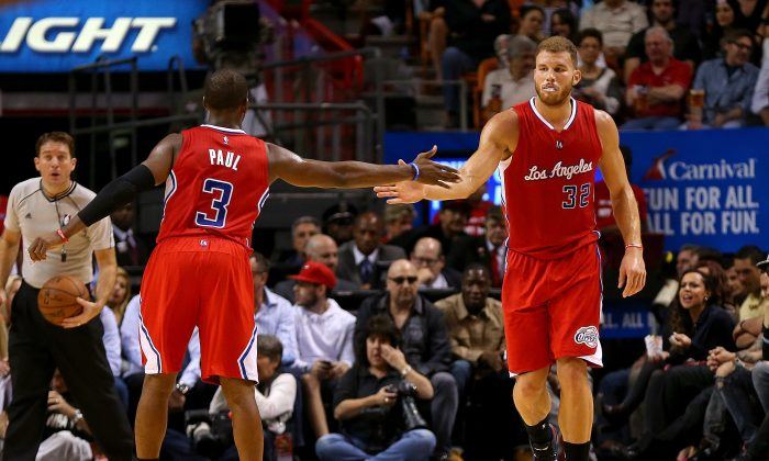Chris Paul #3 and Blake Griffin #32 of the Los Angeles Clippers high five after a play during a game against the Miami Heat at American Airlines Arena on November 20, 2014 in Miami, Florida. (Photo by Mike Ehrmann/Getty Images)