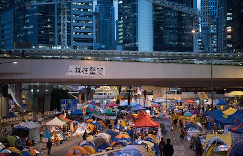 People walk down a street at the pro-democracy movement's main protest site in the Admiralty district of Hong Kong on Dec. 4, 2014. (Johannes Eisele/AFP/Getty Images)