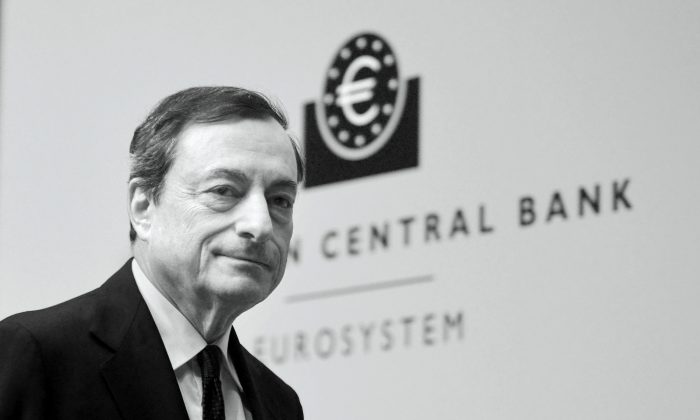 Mario Draghi, President of the European Central Bank pictured during his first press conference following the monthly ECB board meeting in the new ECB headquaters on Dec. 4, 2014, in Frankfurt am Main, Germany. (Thomas Lohnes/Getty Images)