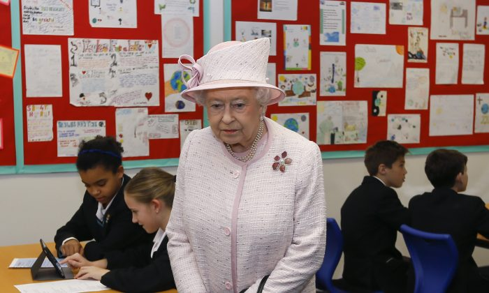Britain's Queen Elizabeth II tours a classroom, during a visit to Holyport College near Maidenhead, Berkshire in England, Friday, Nov. 28, 2014. (AP Photo/Kirsty Wigglesworth, Pool)