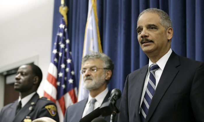 U.S. Attorney General Eric Holder (R), Cleveland Mayor Frank Jackson (C), and Cleveland police chief Calvin Williams (L) in Cleveland on Dec. 4, 2014. (AP Photo/Tony Dejak)