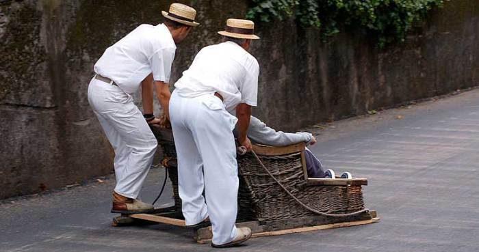 Toboggan riding in Madeira, Portugal. (madeira-web.com)