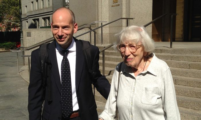 Miriam Moskowitz leaves federal court with her lawyer Guy Eddon in Manhattan, N.Y., on Aug. 25, 2014. Moskowitz lost her bid to persuade a judge to erase her 1950 conviction for conspiracy to obstruct justice in the run-up to the atomic spying trial of Julius and Ethel Rosenberg. (AP Photo/Lawrence Neumeister)