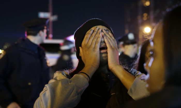 A woman is overcome with emotion during a protest against the grand jury's decision in the Eric Garner case in Times Square on Wednesday. (AP Photo/Seth Wenig)
