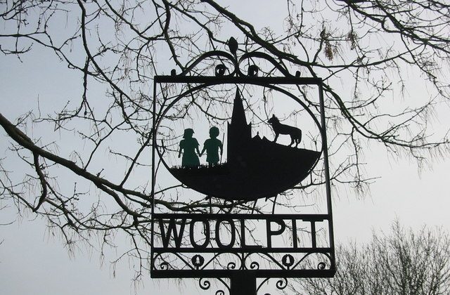 A village sign in Woolpit, England, depicting the two green children of the 12th century legend. (Wikimedia Commons)