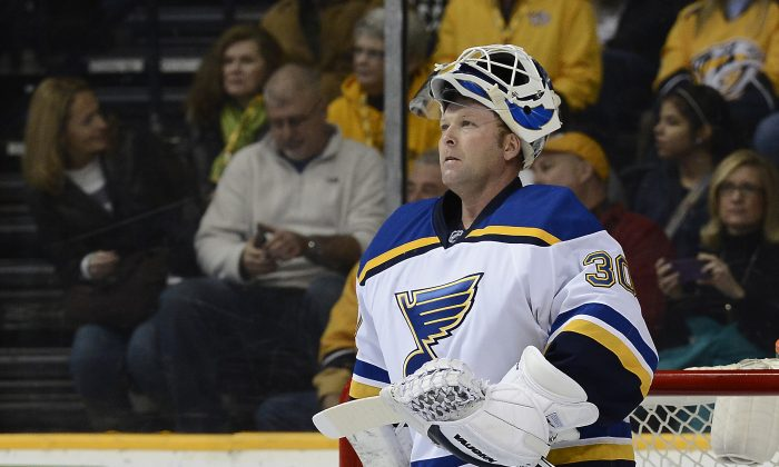 St. Louis Blues goalie Martin Brodeur (30) looks at the scoreboard during a timeout in the first period of an NHL hockey game against the Nashville Predators Thursday, Dec. 4, 2014, in Nashville, Tenn. (AP Photo/Mark Zaleski)
