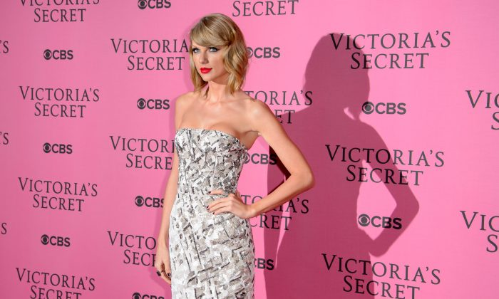 Taylor Swift poses for photographers upon arrival at the Victoria's Secret fashion show in London, Tuesday, Dec. 2, 2014. (Photo by Jonathan Short/Invision/AP)
