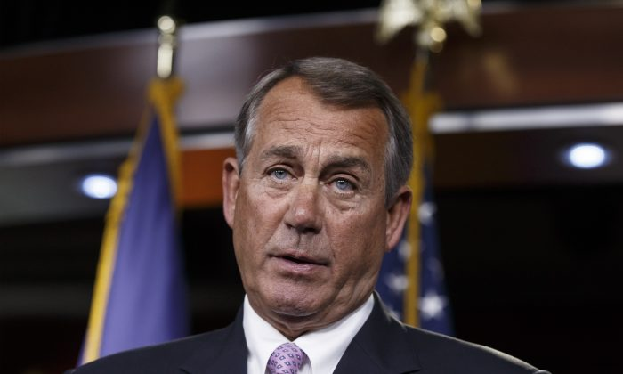 House Speaker John Boehner of Ohio meets with reporters on Capitol Hill in Washington, Thursday, Dec. 4, 2014. Just days before government funding expires. (AP Photo/J. Scott Applewhite)