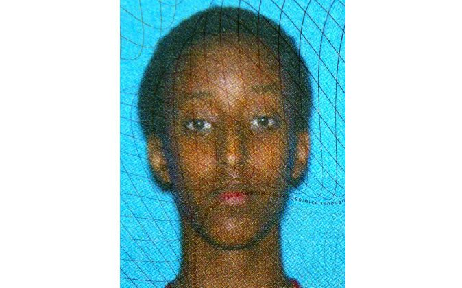 A Department of Motor Vehicles photo courtesy the family shows Abdisamad Sheikh-Hussein. The 15-year-old was struck and killed by a hit-and-run driver in front of the Somali Center of Kansas City, Mo., Thursday, Dec. 4, 2014. (AP Photo)