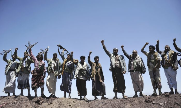 """FILE - In this Sept. 22, 2014 file photo, Hawthi Shiite rebels chant slogans at the compound of the army's First Armored Division, after they took it over, in Sanaa, Yemen. The world celebrated the """"Arab Spring"""" as evidence that the huddled masses of the Middle East, like people everywhere, are simply yearning to be free. But time has not been kind to the optimists. (AP Photo/Hani Mohammed, File)"""