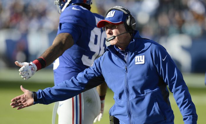 New York Giants head coach Tom Coughlin reaches to congratulate Andre Williams, not shown, after Williams scored a touchdown on a 50-yard run against the Tennessee Titans in the second half of an NFL football game Sunday, Dec. 7, 2014, in Nashville, Tenn. (AP Photo/Mark Zaleski)