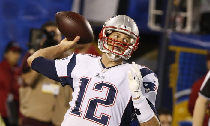 New England Patriots quarterback Tom Brady throws a pass against the San Diego Chargers during the first half in an NFL football game Sunday, Dec. 7, 2014, in San Diego. (AP Photo/Lenny Ignelzi)