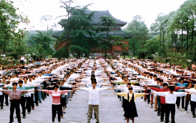 Falun Gong practitioners gather in a park in Chengdu City, China, for morning exercises some time in the 1990s, before the persecution against the meditation practice began. (Faluninfo.net)