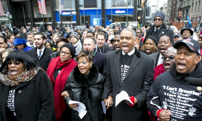 Community leaders and protesters partially blocked Broadway St. across from City Hall in New York City on Dec. 8, 2014, to voice their concerns over white police officers killing unarmed black men. (Samira Bouaou/Epoch Times)