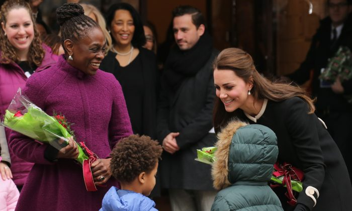DEC 9: Catherine, Duchess of Cambridge (R) and New York City Mayor Bill de Blasio's wife, Chirlane McCray, greet guests at the Northside Center for Child Development  in New York City on Dec. 8, 2014. Prince William, Duke of Cambridge and Catherine, Duchess of Cambridge are on their official two-day visit to the United States. (Neilson Barnard/Getty Images)