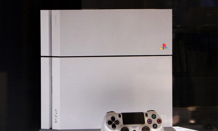 Sony Computer Entertainment's PlayStation 4 20th anniversary edition video game console is displayed at Sony's showroom in Tokyo on Dec. 4, 2014. (Yoshikazu Tsuno/AFP/Getty Images)