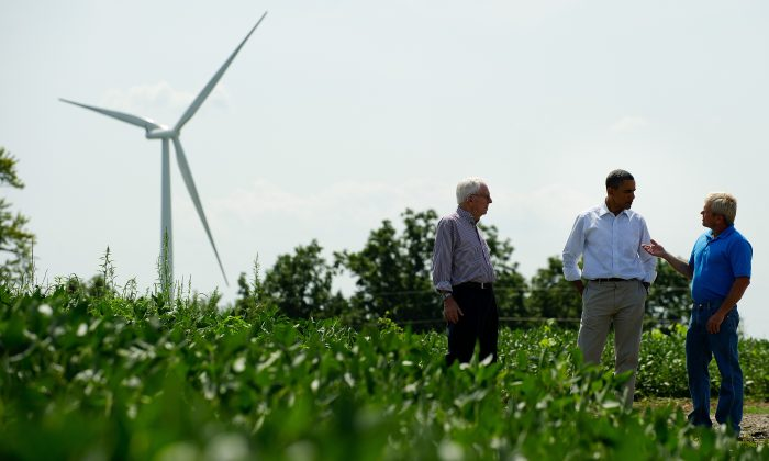 President Barack Obama (C) talks with Richard (L) and Jeff Heil (R) before delivering remarks on wind power at the Heil Family Farm in Haverhill, Iowa, on Aug. 14, 2012. (Jim Watson/AFP/GettyImages)