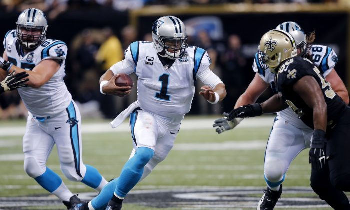 Cam Newton was injured in a car crash in Charlotte after a car overturned, according to a report. Carolina Panthers quarterback Cam Newton (1) carries in the first half of an NFL football game against the New Orleans Saints in New Orleans, Sunday, Dec. 7, 2014. (AP Photo/Bill Haber)