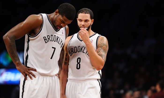 Joe Johnson #7 and Deron Williams #8 of the Brooklyn Nets talk during the second half against the Washington Wizards at Barclays Center on December 18, 2013 in the Brooklyn borough of New York City. (Photo by Maddie Meyer/Getty Images)