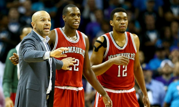 Head coach Jason Kidd of the Milwaukee Bucks reacts with his players Khris Middleton #22 and Jabari Parker #12 of the Milwaukee Bucks during their game against the Charlotte Hornets at Time Warner Cable Arena on October 29, 2014 in Charlotte, North Carolina. (Photo by Streeter Lecka/Getty Images)