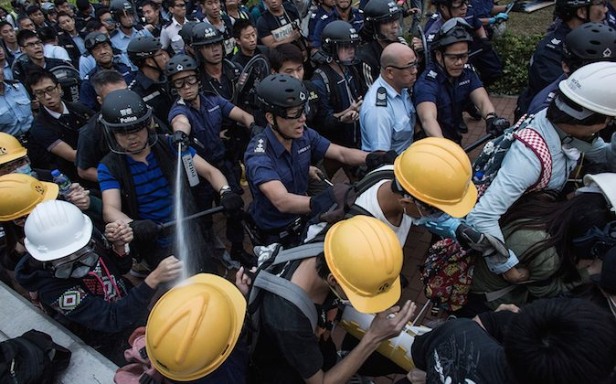 Riot police clash with pro-democracy protesters outside Central Government Complex at admiralty district on December 1, 2014 in Hong Kong. (Lam Yik Fei/Getty Images)