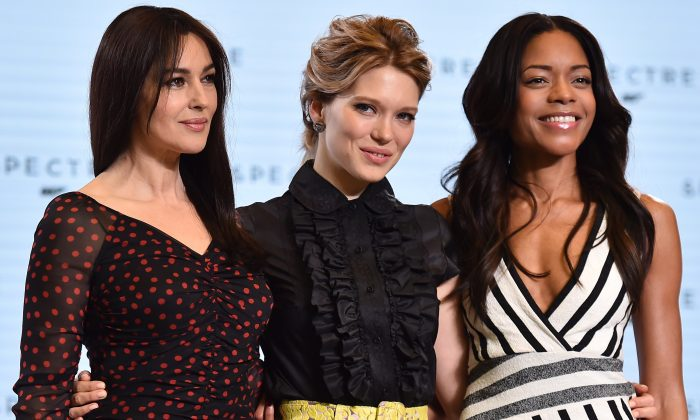 Italian actress Monica Bellucci (L), French actress Lea Seydoux (C) and British actress Naomi Harris (R) pose during an event to launch the 24th James Bond film 'Spectre' at Pinewood Studios at Iver Heath in Buckinghamshire, west of London, on December 4, 2014. French actress Lea Seydoux and Italian star Monica Bellucci will star alongside Britain's Daniel Craig in the new James Bond film 'Spectre', the producers said on December 4 at the historic Pinewood Studios. (Ben Stansall/AFP/Getty Images)