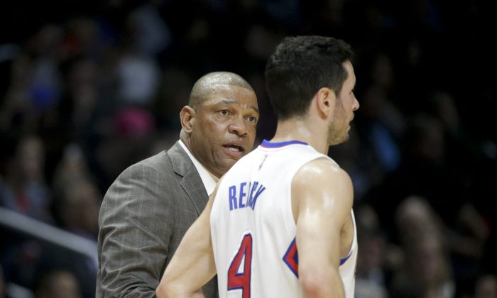 Los Angeles Clippers head coach Doc Rivers talks to J.J. Redick during the second half of an NBA basketball game against the Orlando Magic Wednesday, Dec. 3, 2014, in Los Angeles. The Clippers won 114-86. (AP Photo/Jae C. Hong)