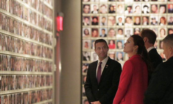 Kate, Duchess of Cambridge, and Britain's Prince William are escorted by Joe Daniels, president & CEO of the National September 11 Memorial & Museum in the Hall of Faces, during their visit to the National September 11 Museum, Tuesday, Dec. 9, 2014. Prince William and Kate are on the last of their 3-day tour of New York City, their first visit to the United States since a trip to California in 2011. (AP Photo/Richard Drew)