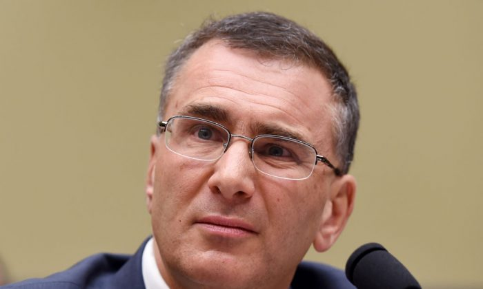 """MIT economist Jonathan Gruber listens as he testifies on Capitol Hill in Washington, Tuesday, Dec. 9, 2014, before the House Oversight Committee health care hearing. Congressional Democrats charged Tuesday that Republicans are seizing on a health adviser's self-described """"thoughtless"""" and misleading remarks to attack President Barack Obama's signature health care law. (AP Photo/Molly Riley)"""