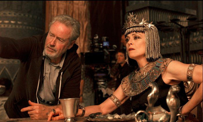 """Director Ridley Scott and actress Sigourney Weaver on the set of """"Exodus: Gods and Kings."""" """"Exodus"""" stars Christian Bale as Moses, Joel Edgerton as pharaoh-to-be Ramses, John Turturro as the Egyptian leader and Weaver as his queen. (AP Photo/Twentieth Century Fox, Kerry Brown)"""