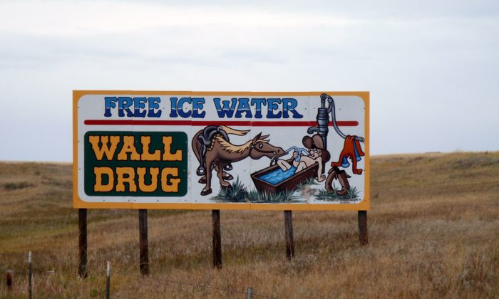 There are about 200 billboard signs that proclaim Wall Drug along South Dakota highways. This one mimics the very first sign Dr. Ted Hustead put up at the suggestion of his wife Dorothy in 1936. It offered thirsty travelers free ice water. The tradition continues and coffee is still five cents. (Myriam Moran copyright 2014)