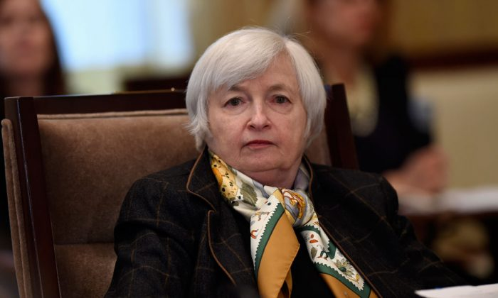 Federal Reserve Chair Janet Yellen attends the Board of Governors of the Federal Reserve System open meeting at the Federal Reserve Building in Washington, Tuesday, Dec. 9, 2014, to discuss a proposal to establish risk-based capital surcharges for systemically important bank holding companies. (AP Photo/Susan Walsh)