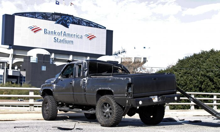 Cam Newton reportedly suffered two lower transverse fractures in his lower back due to a car accident he was in on Tuesday, according to a report. The damaged truck driven by Carolina Panthers quarterback Cam Newton sits near Bank of America Stadium after the quarterback was involved in an accident, Tuesday, Dec. 9, 2014, in Charlotte, N.C. Newton was taken to the hospital. It's unclear how badly the 25-year-old he was injured. (AP Photo/Skip Foreman)