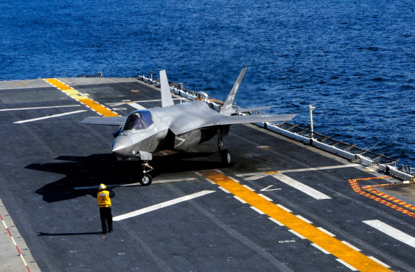 In this handout image provided by the U.S. Navy, an F-35B Lightning II makes the first vertical landing on a flight deck at sea aboard the amphibious assault ship USS Wasp on October 3, 2011 in the Atlantic Ocean. The F-35B is the Marine Corps Joint Strike Force variant of the Joint Strike Fighter and is designed for short takeoff and vertical landing on Navy amphibious ships. (Photo by Natasha R. Chalk/U.S. Navy via Getty Images)