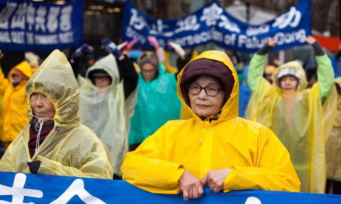Falun Gong practitioners appeal for the end of persecution of their fellow practitioners in China on Human Rights Day in front of the United Nations offices in Manhattan, N.Y., on Dec. 10, 2014. (Petr Svab/Epoch Times)