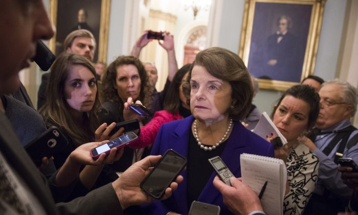 Senate Intelligence Chairwoman Dianne Feinstein (C), a Democrat from California, speaks to reporters about the committee's report on CIA interrogations at the US Capitol in Washington, DC, December 9, 2014 (Saul Loeb/AFP/Getty Images)