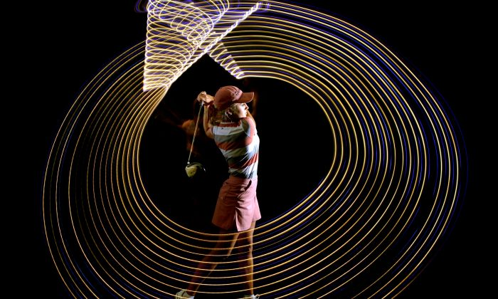 HENDERSON, NV - APRIL 21: Professional Golfer Natalie Gulbis shows the path of her golf swing in a long exposure shot during a Calendar Shoot at the Lake Las Vegas Resort on April 21, 2004 in Henderson Nevada. (Donald Miralle/Getty Images)