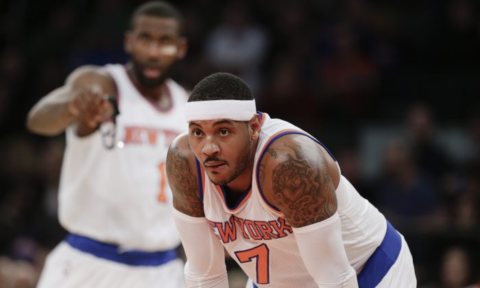 New York Knicks Carmelo Anthony plays during the first half of an NBA basketball game against the Portland Trail Blazers Sunday, Dec. 7, 2014, in New York.  (AP Photo/Frank Franklin II)
