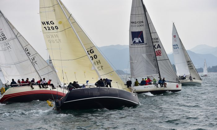 HKPN Boats 'Applause' (1200), 'Getafix', 'Bits & Pieces' and 'X-Terminator' line up for the start of Race-5, the first race on Day-3 of the Hebe Haven Yacht Club, UK Sailmakers Winter Saturday Series on Saturday Dec. 6, 2014. (Bill Cox/Epoch Times)