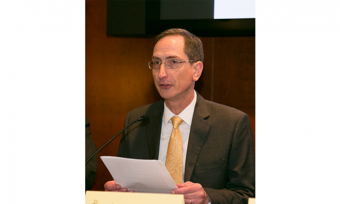 John Nania, editor-in-chief of the English-language editions of the Epoch Times, speaking at the Nine Commentaries 10th anniversary forum in the Capitol Visitor's Center in Washington, D.C., on Dec. 3, 2014. (Lisa Fan/Epoch Times)
